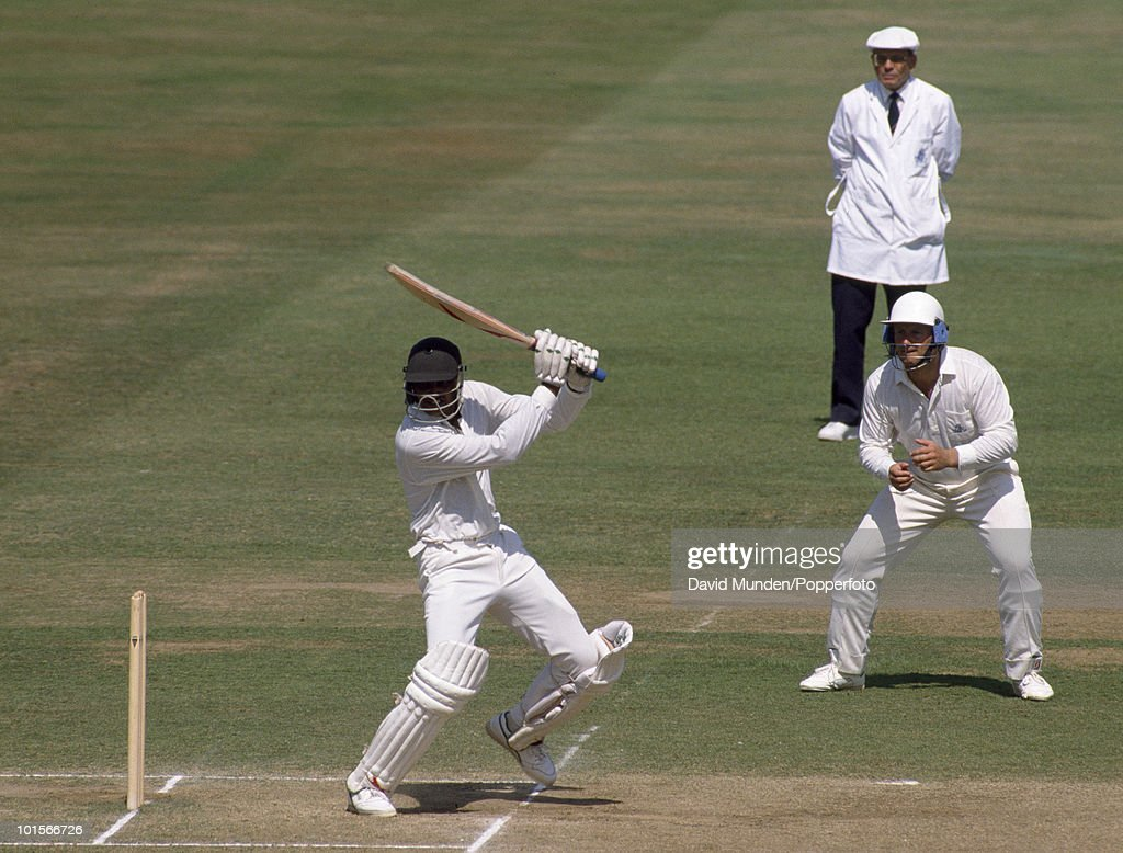 Mohammad Azharuddin batting for India on the fifth day of the 1st Test Match between England and India at Lord's Cricket Ground in London, 31st July 1990. The England fielder is John Morris, and the umpire is Dickie Bird. England won by 247 runs.