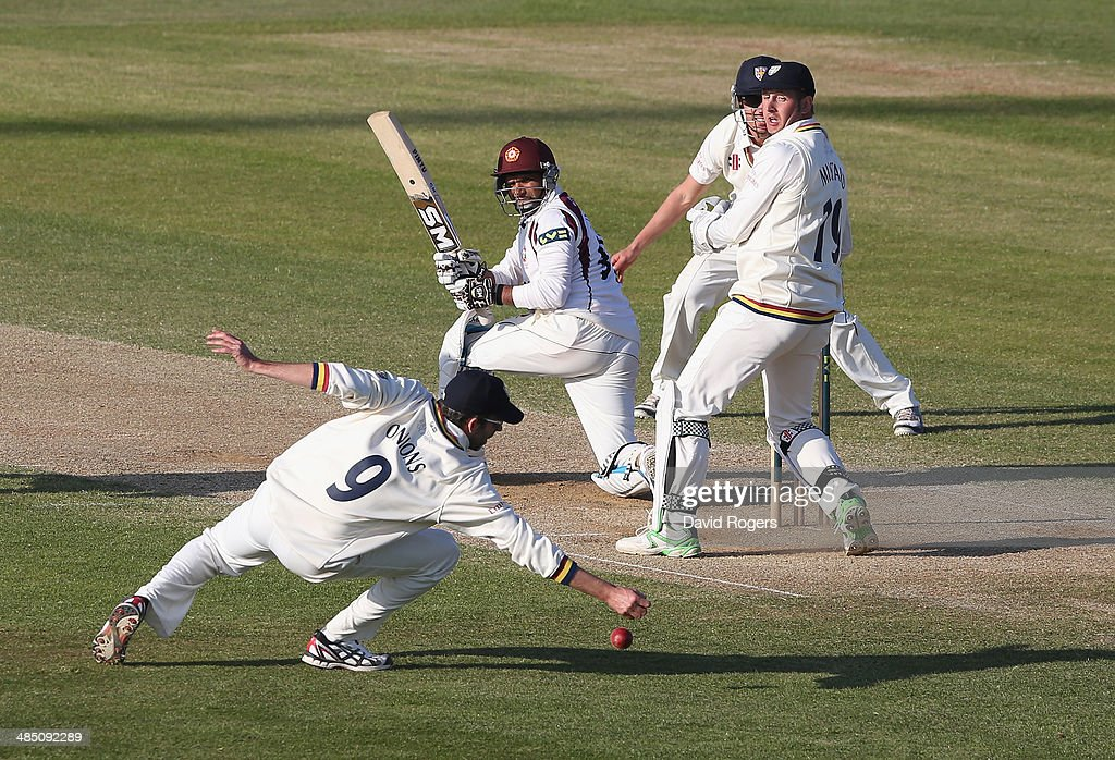 Mohammad Azhaullah of Northamptonshire watches as Graham Onions drops a difficult chance which would have resulted in a win for Durham during the...