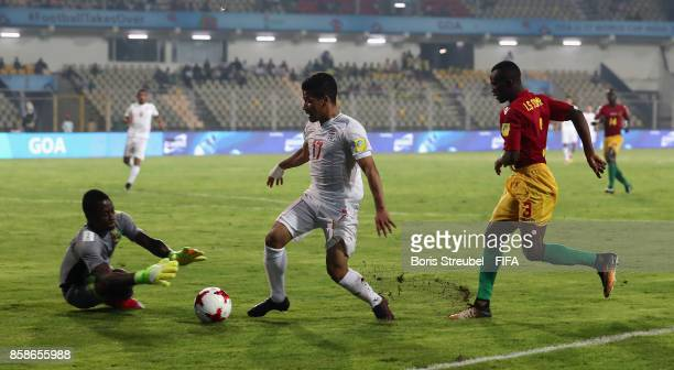 Mohammad Ghaderi of Iran is callenged by goalkeeper Ibrahima Sylla of Guinea and Ibrahima Soumah of Guinea during the FIFA U17 World Cup India 2017...