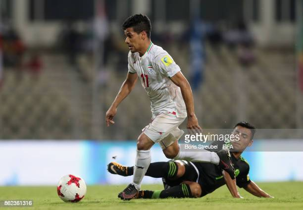 Mohammad Ghaderi of Iran is challenged by Jairo Torres of Mexico during the FIFA U17 World Cup India 2017 Round of 16 match between Iran and Mexico...