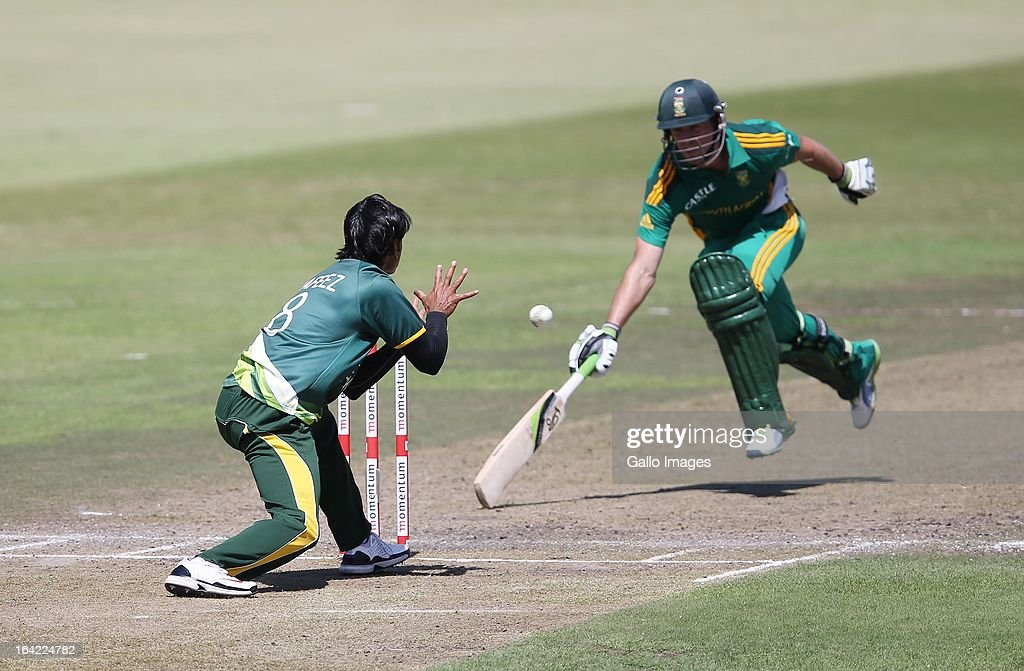 Mohammad Hafeez of Pakistan almost runs out David Miller of South Africa during the 4th Momentum ODI match between South Africa and Pakistan from Sahara Stadium Kingsmead on March 21, 2013 in Durban, South Africa.