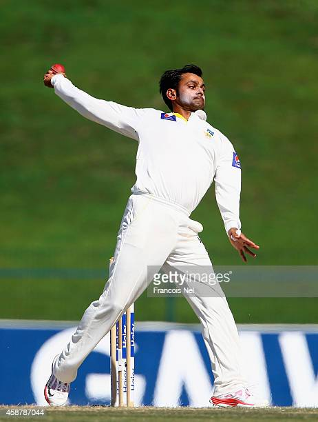 Mohammad Hafeez of Pakistan bowls during Day Three of the First Test between Pakistan and New Zealand at Sheikh Zayed stadium on November 11 2014 in...