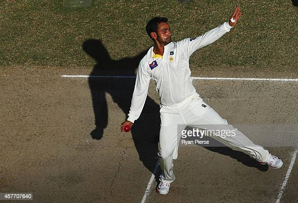 Mohammad Hafeez of Pakistan bowls during Day Two of the First Test between Pakistan and Australia at Dubai International Stadium on October 23 2014...