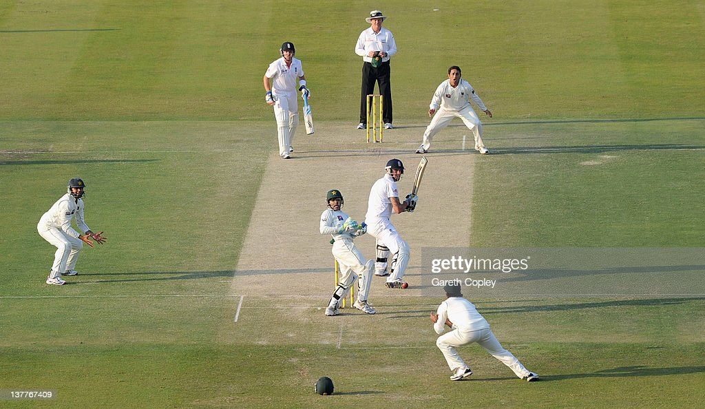 Mohammad Hafeez of Pakistan catches out Kevin Pietersen of England from the bowling of Saeed Ajmal during the second Test match between Pakistan and England at Sheikh Zayed Stadium on January 26, 2012 in Abu Dhabi, United Arab Emirates.