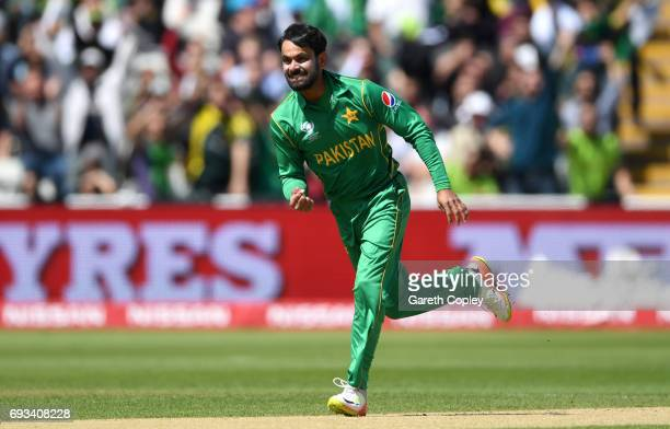 Mohammad Hafeez of Pakistan celebrates dismissing Quinton de Kock of South Africa during the ICC Champions Trophy match between Pakistan and South...
