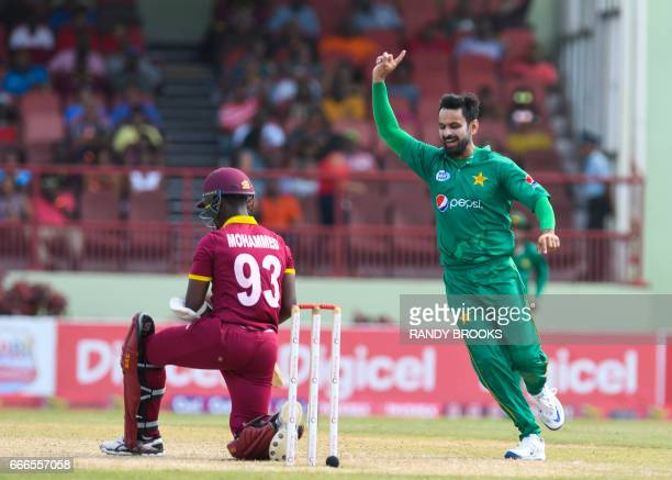 Mohammad Hafeez of Pakistan celebrates the dismissal of Jason Mohammed of West Indies during the 2nd ODI match between West Indies and Pakistan at...