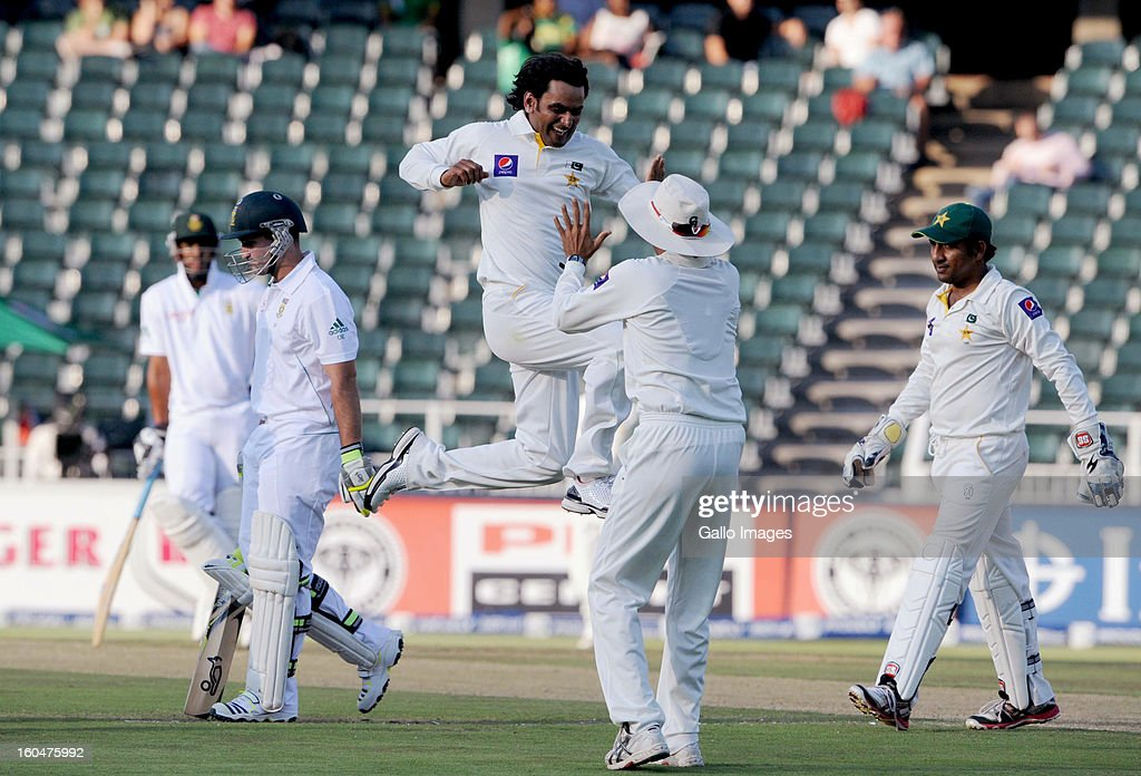 Mohammad Hafeez of Pakistan celebrates the wicket of Dean Elgar of South Africa with his team mates, during day 1 of the first Test match between South Africa and Pakistan at Bidvest Wanderers Stadium on February 01, 2013 in Johannesburg, South Africa.