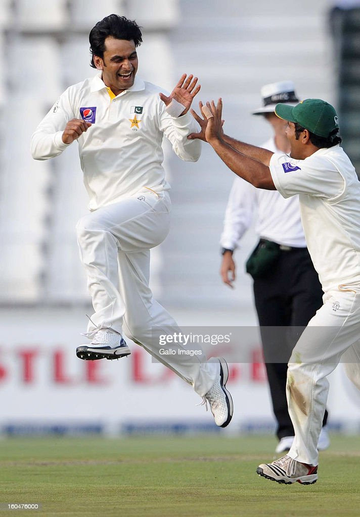 <a gi-track='captionPersonalityLinkClicked' href=/galleries/search?phrase=Mohammad+Hafeez&family=editorial&specificpeople=2237440 ng-click='$event.stopPropagation()'>Mohammad Hafeez</a> of Pakistan celebrates the wicket of Robin Peterson of South Africa during day 1 of the first Test match between South Africa and Pakistan at Bidvest Wanderers Stadium on February 01, 2013 in Johannesburg, South Africa.