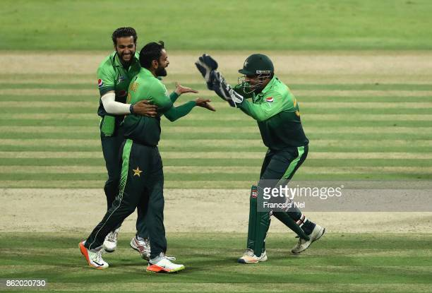 Mohammad Hafeez of Pakistan celebrates with teammates after dismissing Thisara Perera of Sri Lanka during the second One Day International match...