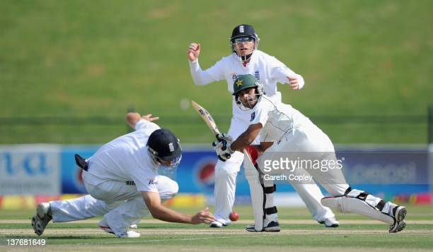 Mohammad Hafeez of Pakistan hits past Alastair Cook of England during the second Test match between Pakistan and England at Sheikh Zayed Stadium on...