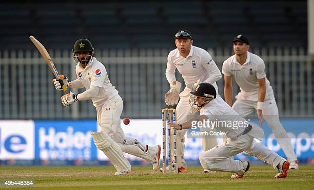 Mohammad Hafeez of Pakistan hits past James Taylor of England during day three of the 3rd Test between Pakistan and England at Sharjah Cricket...