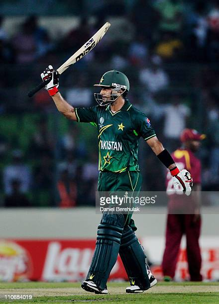 Mohammad Hafeez of Pakistan lifts his bat on scoring his half century during the first quarterfinal match of the ICC Cricket World Cup between...