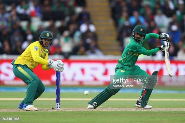 Mohammad Hafeez of Pakistan plays to the offside as wicketkeeper Quinton de Kock looks on during the ICC Champions Trophy match between Pakistan and...