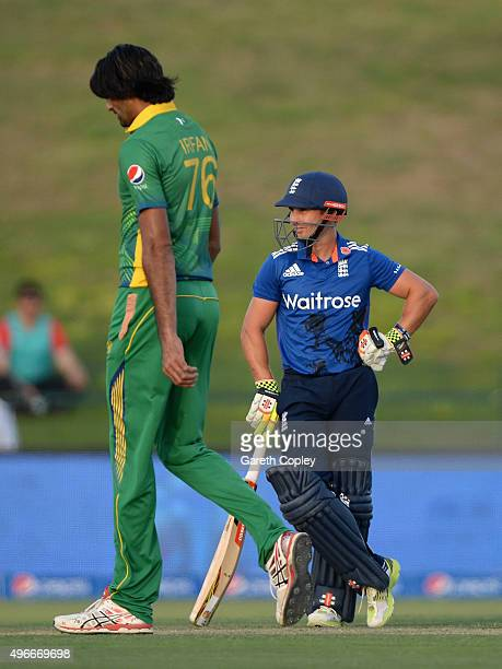Mohammad Irfan of Pakistan alongside James Taylor of England during the 1st One Day International between Pakistan and England at Zayed Cricket...