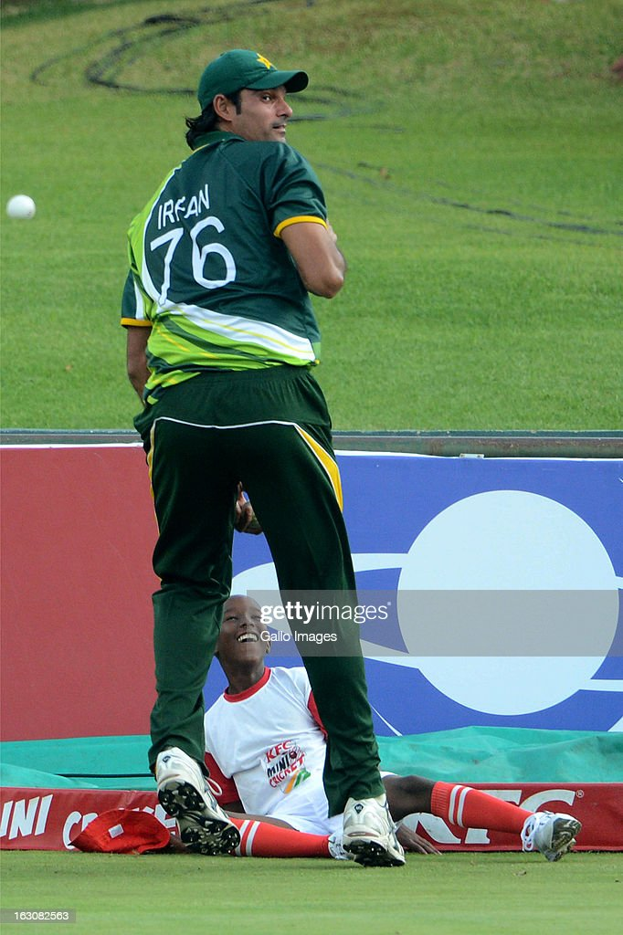 Mohammad Irfan of Pakistan and a ball boy stop the ball hitting the boundary for four during the 2nd T20 match between South Africa and Pakistan at SuperSport Park on March 3, 2013 in Pretoria, South Africa.
