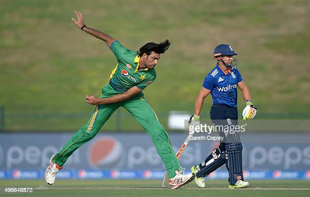 Mohammad Irfan of Pakistan bowls alongside James Taylor of England during the 1st One Day International between Pakistan and England at Zayed Cricket...