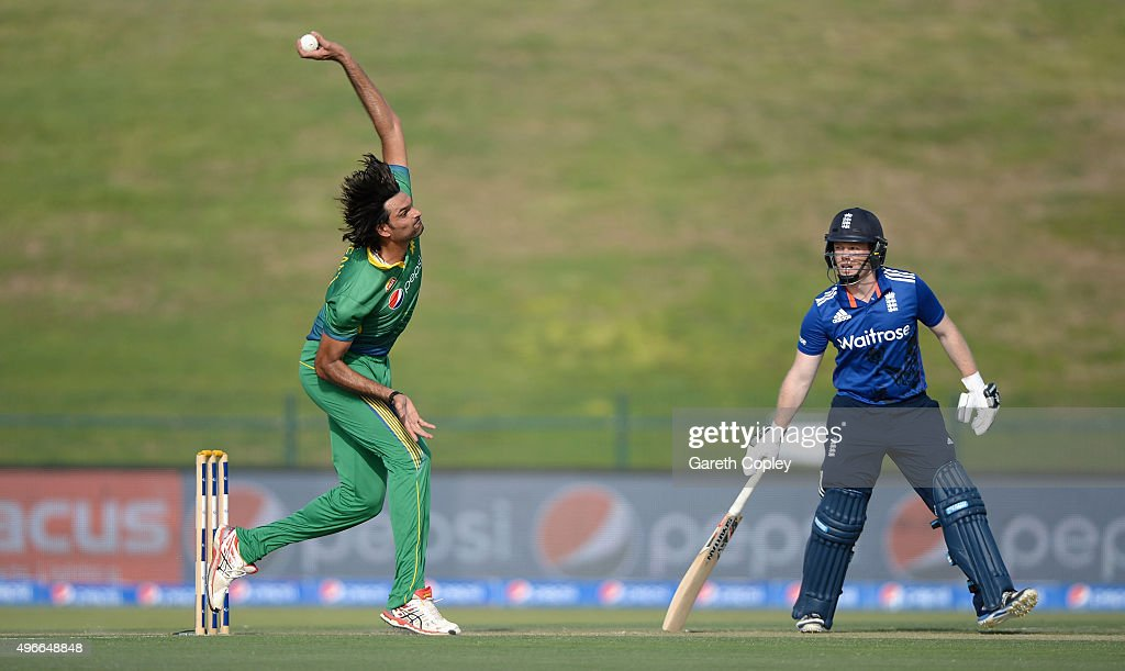 <a gi-track='captionPersonalityLinkClicked' href=/galleries/search?phrase=Mohammad+Irfan+-+Cricketspieler&family=editorial&specificpeople=10986295 ng-click='$event.stopPropagation()'>Mohammad Irfan</a> of Pakistan bowls watched by England captain <a gi-track='captionPersonalityLinkClicked' href=/galleries/search?phrase=Eoin+Morgan&family=editorial&specificpeople=689581 ng-click='$event.stopPropagation()'>Eoin Morgan</a> during the 1st One Day International between Pakistan and England at Zayed Cricket Stadium on November 11, 2015 in Abu Dhabi, United Arab Emirates.