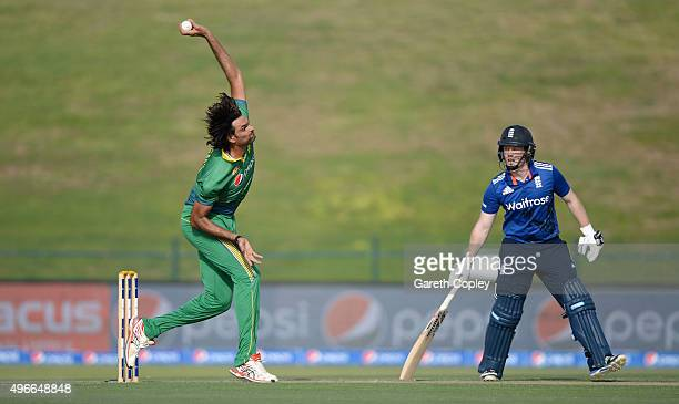 Mohammad Irfan of Pakistan bowls watched by England captain Eoin Morgan during the 1st One Day International between Pakistan and England at Zayed...