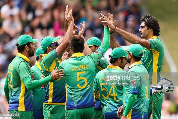 Mohammad Irfan of Pakistan celebrates with teammates after taking the wicket of Martin Guptill of New Zealand during the One Day International match...