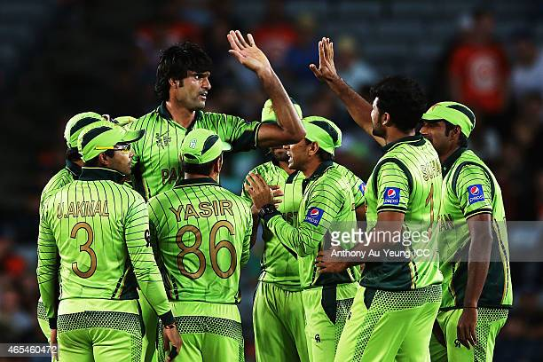Mohammad Irfan of Pakistan celebrates with the team for his wicket of Dale Steyn of South Africa during the 2015 ICC Cricket World Cup match between...
