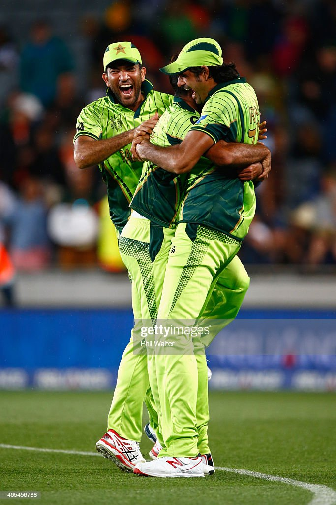 Mohammad Irfan of Pakistan (R) hugs Wahab Riaz (C) and Sarfraz Ahmed (L) after winning the match during the 2015 ICC Cricket World Cup match between South Africa and Pakistan at Eden Park on March 7, 2015 in Auckland, New Zealand.