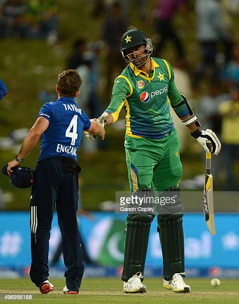 Mohammad Irfan of Pakistan shakes hands with James Taylor of England after the 2nd One Day International between Pakistan and England at Zayed...