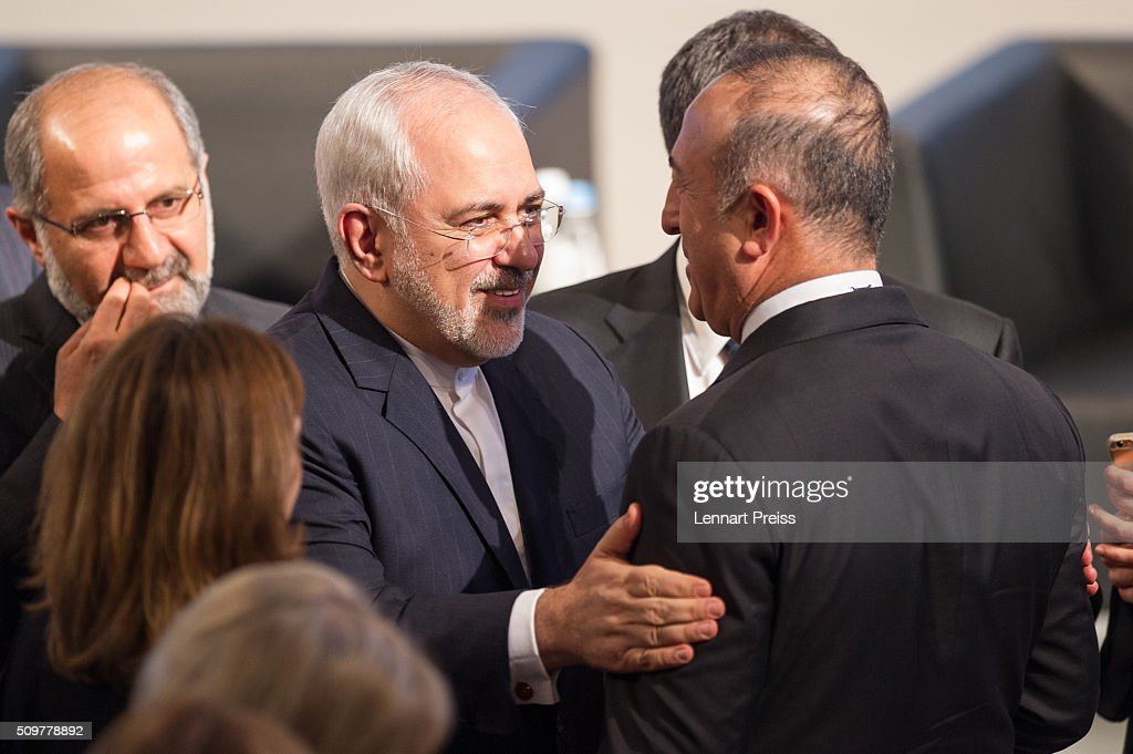 <a gi-track='captionPersonalityLinkClicked' href=/galleries/search?phrase=Mohammad+Javad+Zarif&family=editorial&specificpeople=645041 ng-click='$event.stopPropagation()'>Mohammad Javad Zarif</a> (C), Minister of Foreign Affairs of Iran, talks to turkish Minister of Foreign Affairs, Mevlut Cavusoglu (R) at the 2016 Munich Security Conference at the Bayerischer Hof hotel on February 12, 2016 in Munich, Germany. The annual event brings together government representatives and security experts from across the globe and this year the conflict in Syria will be the main issue under discussion.