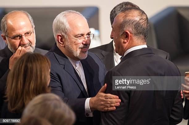 Mohammad Javad Zarif Minister of Foreign Affairs of Iran talks to turkish Minister of Foreign Affairs Mevlut Cavusoglu at the 2016 Munich Security...