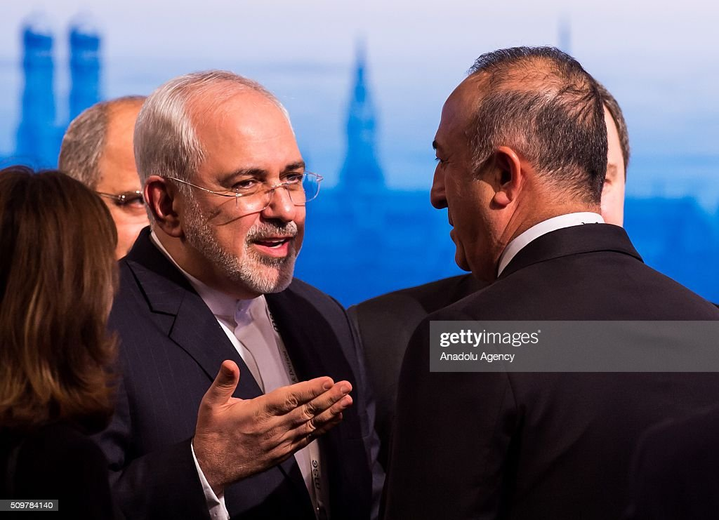 Mohammad Javad Zarif (L), Minister of Foreign Affairs of Iran, talks to Turkish Minister of Foreign Affairs, Mevlut Cavusoglu (R) at the 2016 Munich Security Conference at the Bayerischer Hof hotel on February 12, 2016 in Munich, Germany. The annual event brings together government representatives and security experts from across the globe and this year the conflict in Syria will be the main issue under discussion.