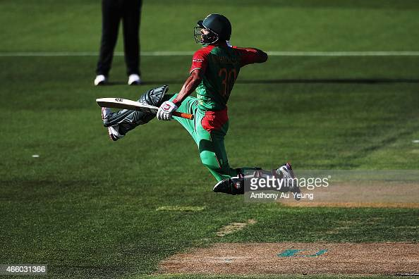 Mohammad Mahmudullah of Bangladesh celebrates after scoring a century during the 2015 ICC Cricket World Cup match between Bangladesh and New Zealand...