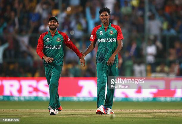 Mohammad Mithun and Mushfiqur Rahim of Bangladesh celebrate after taking the wicket of Mitchell Marsh of Australia during the ICC World Twenty20...