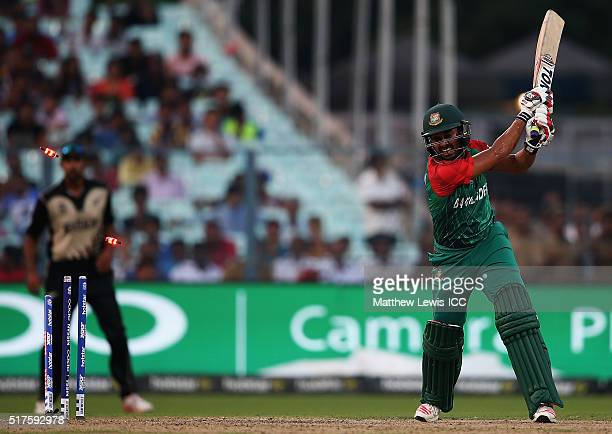 Mohammad Mithun of Bangladesh is bowled by Mitchell McClenaghan of New Zealand during the ICC World Twenty20 India 2016 match between Bangladesh and...