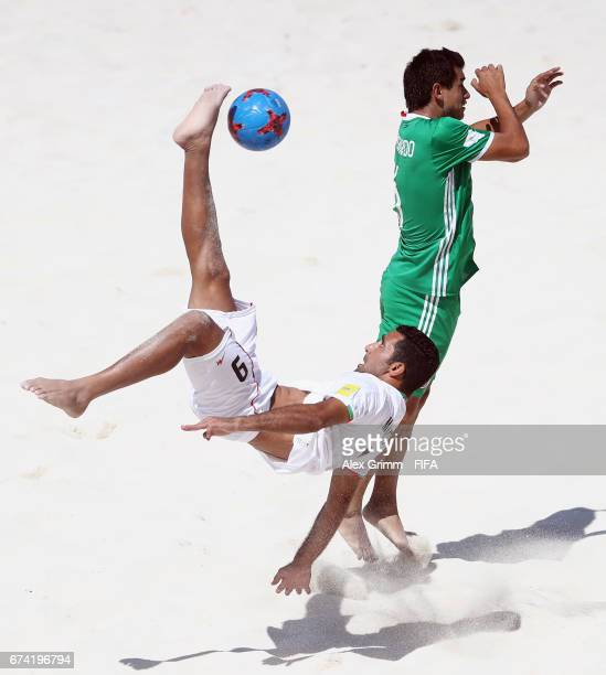 Mohammad Mokhtari of Iran attempts a bicycle kick next to Gonzalo Pichardo of Mexico during the FIFA Beach Soccer World Cup Bahamas 2017 group B...
