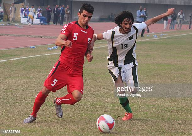 Mohammad Mujtaba of Afganistan and Ahsanullah of Pakistan during International friendly match at Punjab football stadium in Lahore Pakistan on...