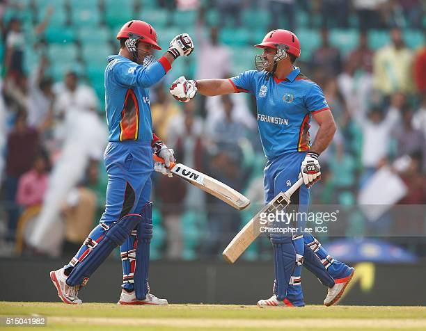 Mohammad Nabi and Samiullah Shenwari of Afghanistan celebrate scoring another boundary during the ICC Twenty20 World Cup Round 1 Group B match...