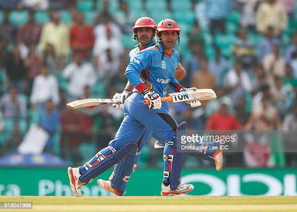 Mohammad Nabi and Samiullah Shenwari of Afghanistan runs between the stumps to scores more runs during the ICC Twenty20 World Cup Round 1 Group B...