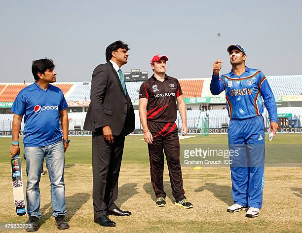 Mohammad Nabi captain of Afghanistan and Jamie Atkinson captain of Hong Kong at the coin toss with match referee Javagal Srinath and pepsi mascot...
