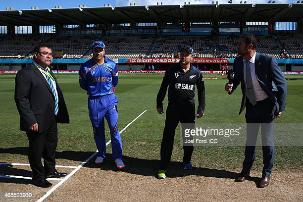 Mohammad Nabi of Afghanistan and Brendon McCullum of New Zealand take part in the coin toss during the 2015 ICC Cricket World Cup match between New...