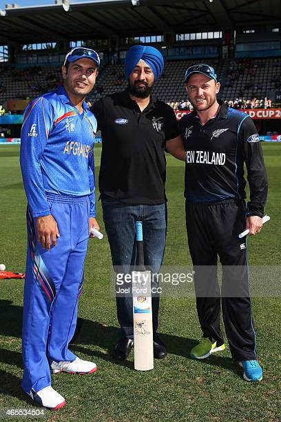 Mohammad Nabi of Afghanistan and Brendon McCullum of New Zealand take with Pepsi mascot Palwinder Singh during the 2015 ICC Cricket World Cup match...