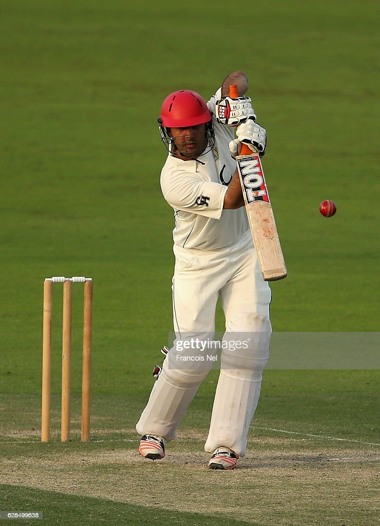 Mohammad Nabi of Afghanistan bats during day two of the tour match between England Lions and Afghanistan at Zayed Cricket Stadium on December 8, 2016 in Abu Dhabi, United Arab Emirates.