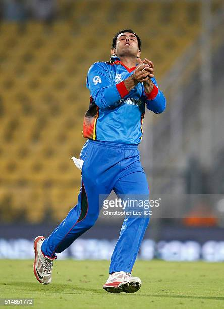 Mohammad Nabi of Afghanistan catches out Kinchit Shah of Hong Kong after he bowled to him during the ICC Twenty20 World Cup Round 1 Group B match...
