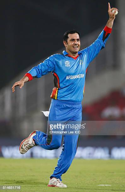 Mohammad Nabi of Afghanistan celebrates catching and bowling out Kinchit Shah of Hong Kong during the ICC Twenty20 World Cup Round 1 Group B match...