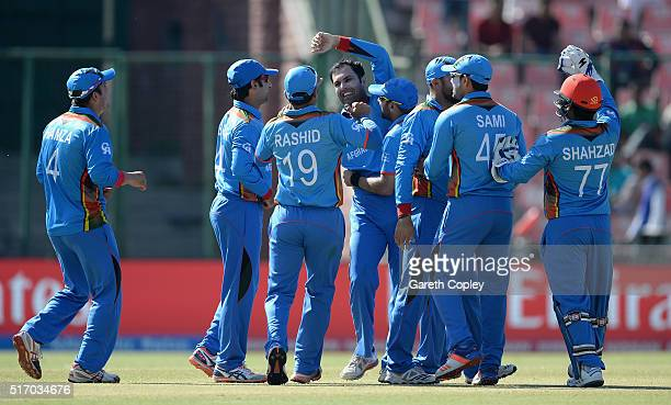 Mohammad Nabi of Afghanistan celebrates with teammates after dismissing England captain Eoin Morgan during the ICC World Twenty20 India 2016 Group 1...