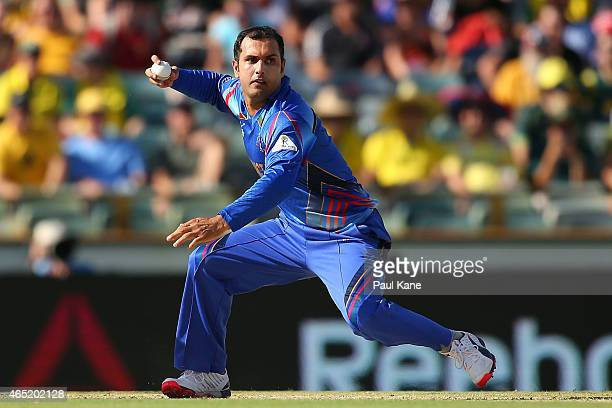 Mohammad Nabi of Afghanistan looks for a run out during the 2015 ICC Cricket World Cup match between Australia and Afghanistan at WACA on March 4...