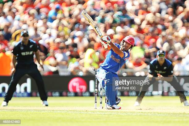 Mohammad Nabi of Afghanistan plays a shot during the 2015 ICC Cricket World Cup match between New Zealand and Afghanistan at McLean Park on March 8...