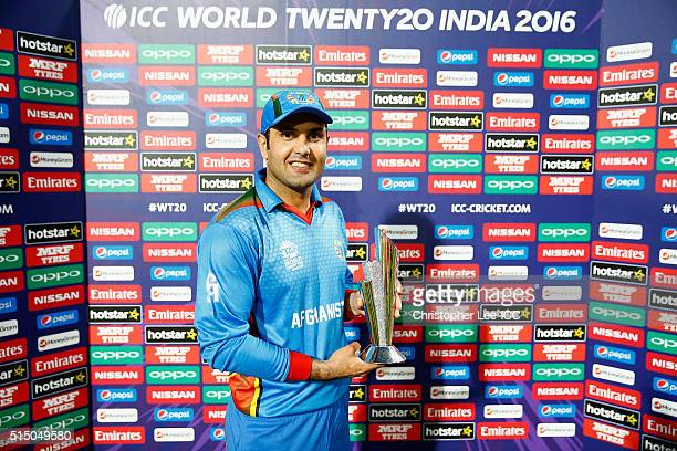 Mohammad Nabi of Afghanistan poises for the camera with his Player of the Match award during the ICC Twenty20 World Cup Round 1 Group B match between...