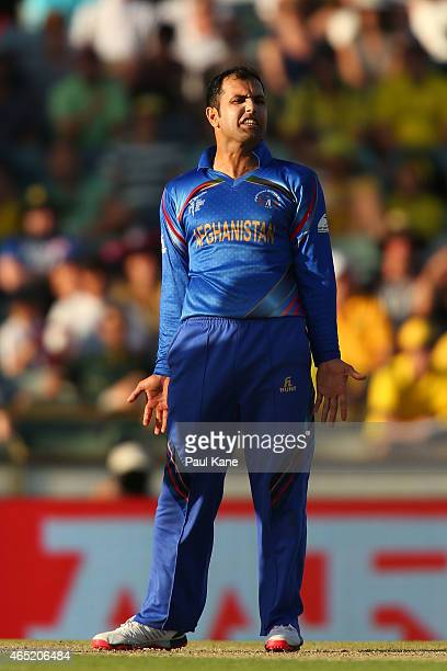 Mohammad Nabi of Afghanistan reacts after a delivery during the 2015 ICC Cricket World Cup match between Australia and Afghanistan at WACA on March 4...