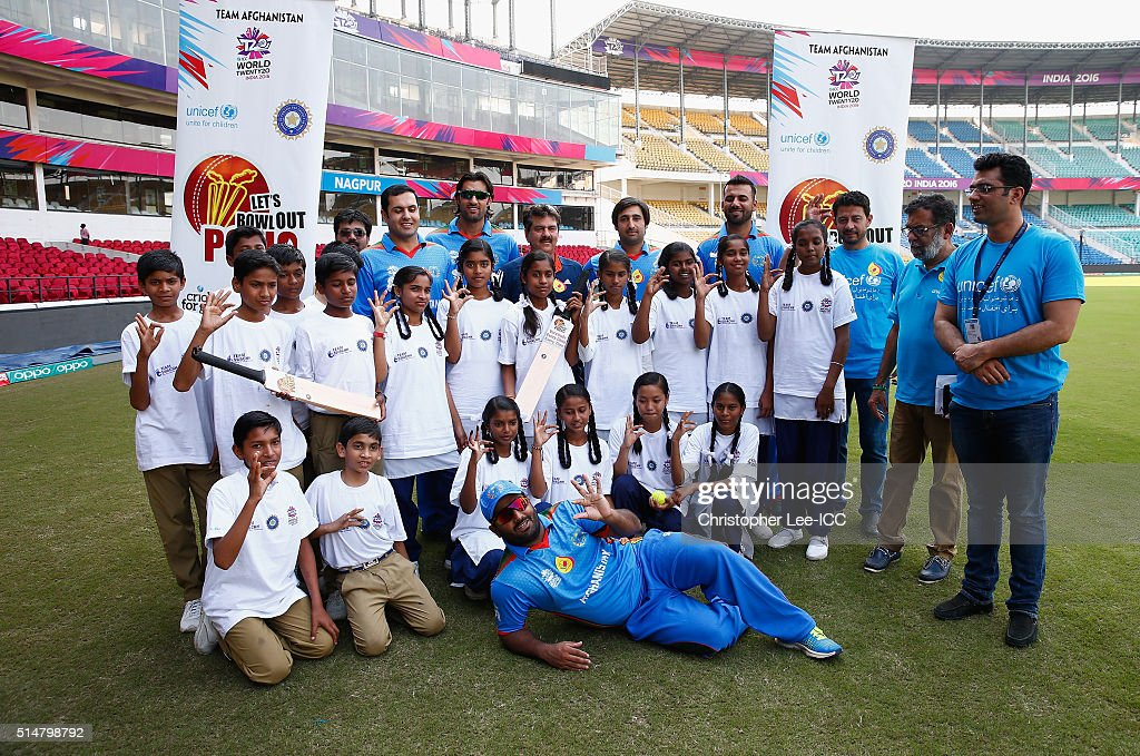 Mohammad Nabi, Shapoor Zadran, Asghar Stanikzai, Mohammad Shahzad and Dawlat Zadran of Afghanistan pose for the camera's with local kids during the ICC Cricket For Good and Team Swachh cricket clinics in partnership with UNICEF at the Vidarbha Cricket Association Stadium on March 11, 2016 in Nagpur, India.