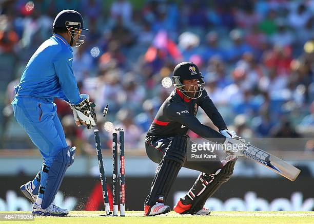 Mohammad Naveed of the UAE is bowled by Ravichandran Ashwin of India during the 2015 ICC Cricket World Cup match between India and the United Arab...