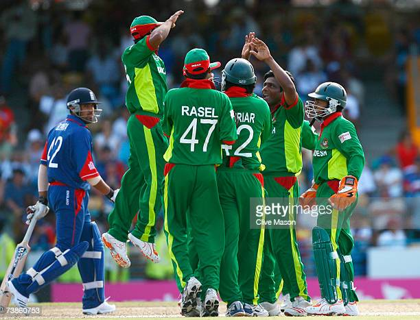 Mohammad Rafique of Bangladesh celebrates the wicket of Ravi Bopara of England with team mates during the ICC Cricket World Cup Super Eights match...